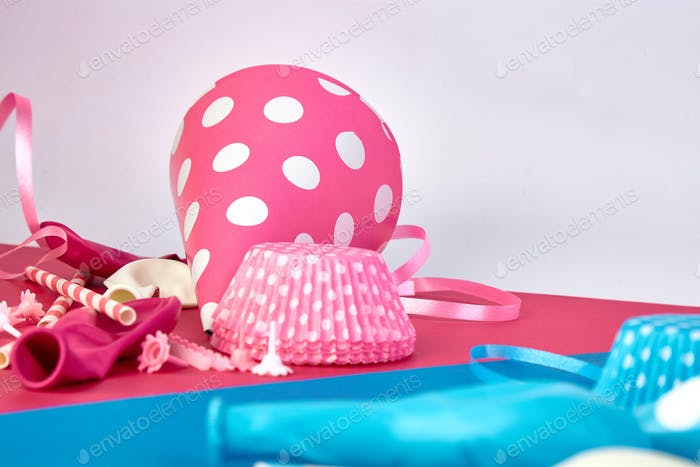 Party pink and blue paper hat.