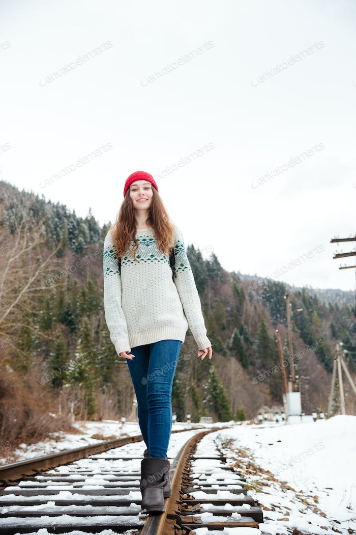 Woman walking on railway