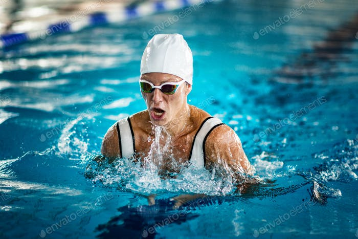 Female swimmer on training in the swimming pool
