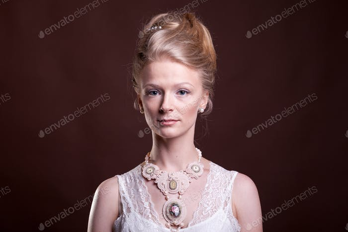 Gorgeous beautiful woman in vintage victorian dress