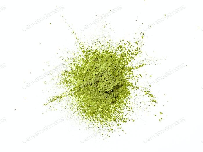 Green matcha tea powder explosion,white background