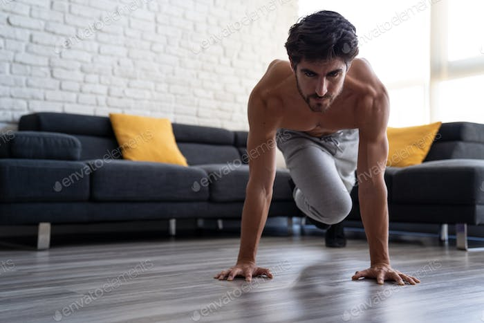 Portait Athletic White Young Man Doing Abs Workout Home Alone