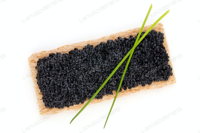 Canapes with black sturgeon caviar and  spice isolated on the white background.