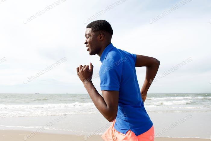african american man running at beach