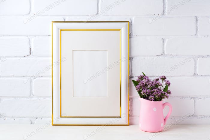 Gold decorated frame mockup with purple flowers in pink rustic p