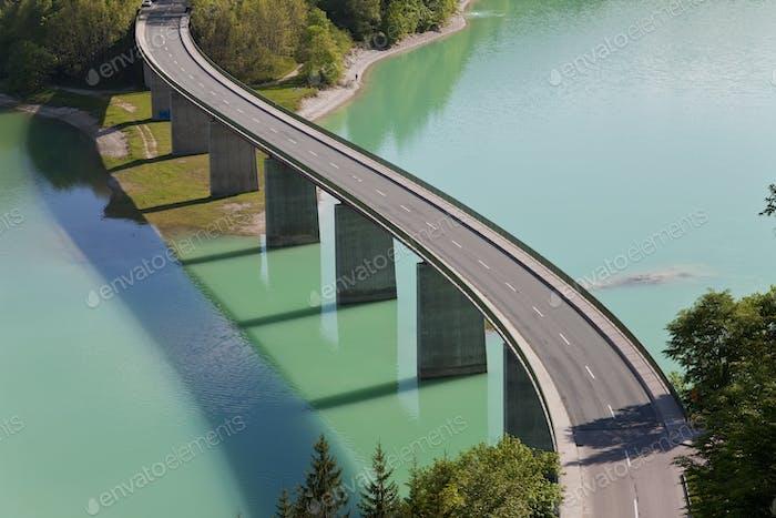 High angle view of tall road bridge crossing dam