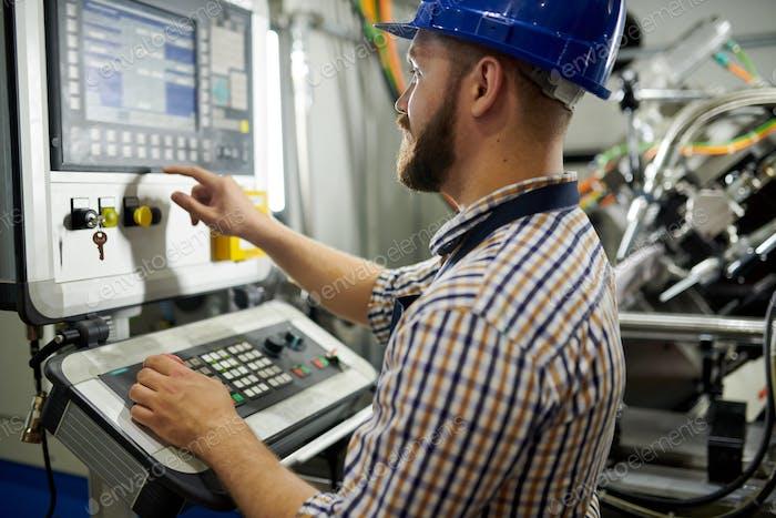 Worker Using Machines