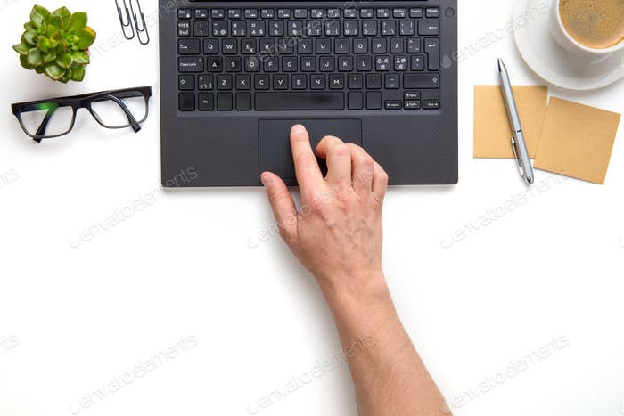 Businessman Touching Touchpad On Laptop At White Desk