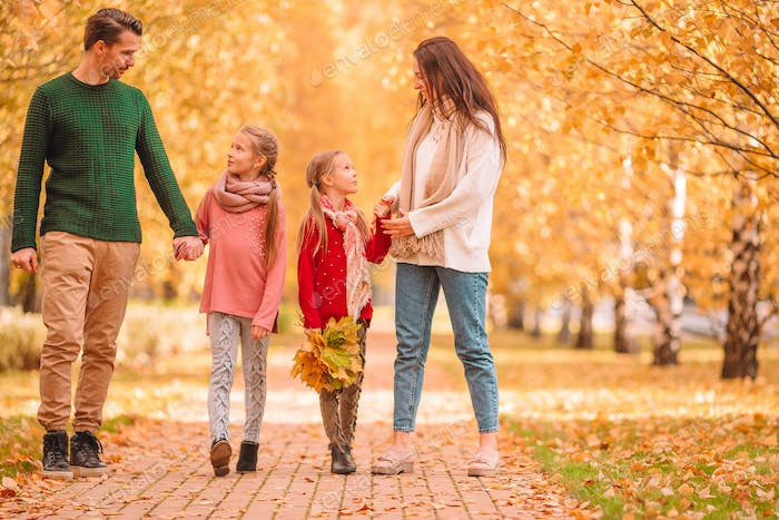 Portrait of happy family of four in autumn