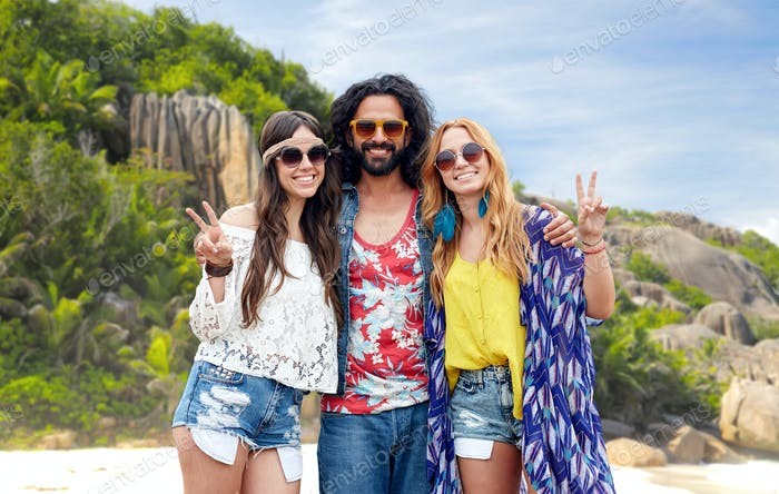 happy hippie friends showing peace on island beach