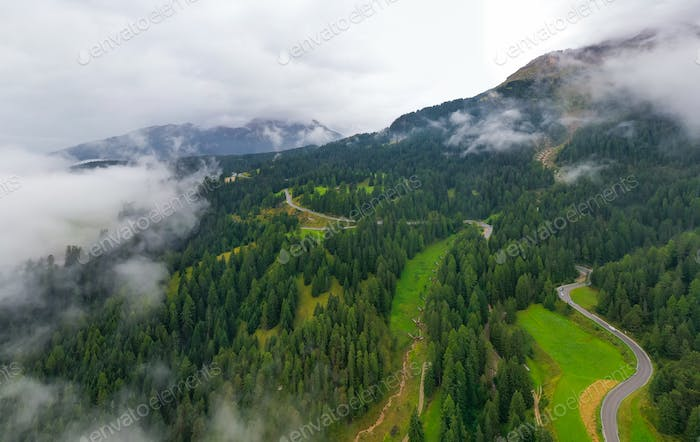 Beautiful aerial panoramic view of the Dolomites Alps, Italy. Mountains covered by clouds and fog