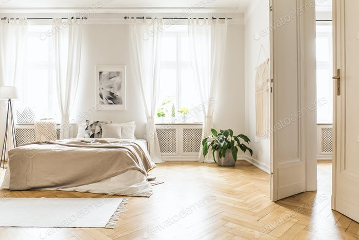 Spacious and bright bedroom interior with beige decorations, har
