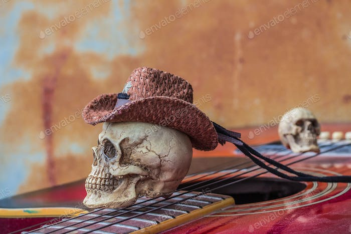 The skull cap at the top guitarist