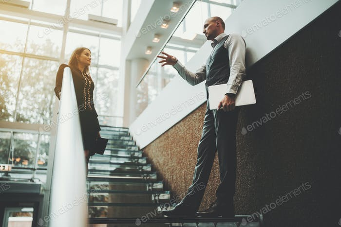 Business talk on an office staircase