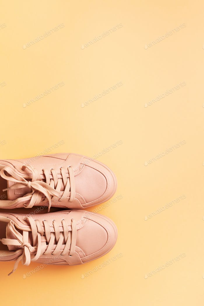 Woman fashion pink shoes on pink background with copy space. Top view. Flat lay. Fitness, sport