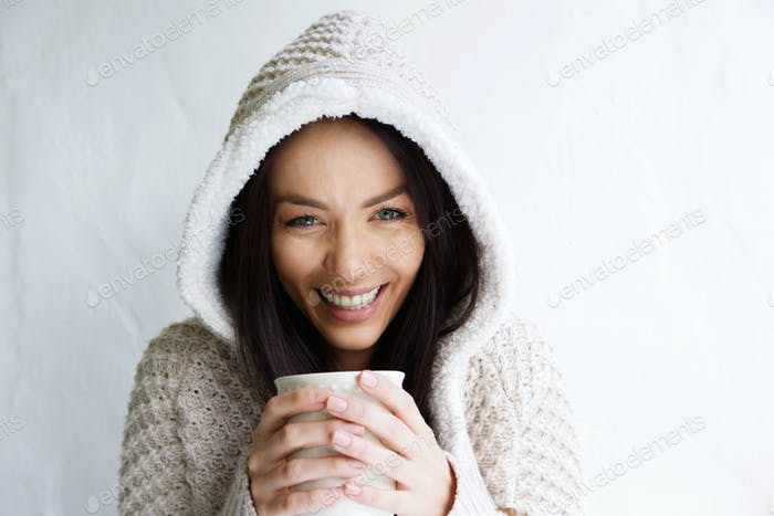 Smiling young lady holding coffee cup