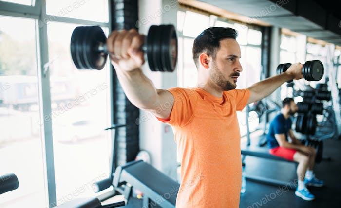 Determined male exercising in gym