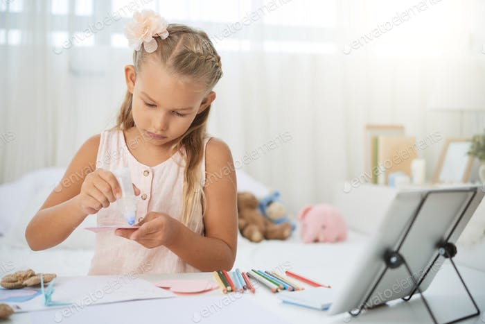 Girl making girl card