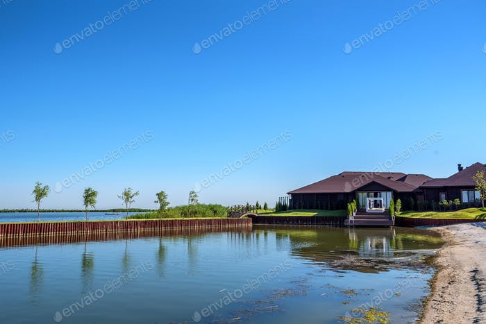 Beautiful view of cottage and pier on river
