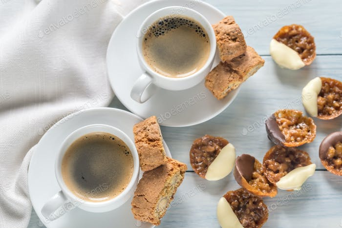Cups of coffee with florentine cookies