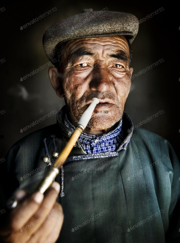 Mongolian Traditional Dress Smoking Pipe Solitude Concept