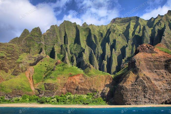 Jagged hills from catamaran at the dramatic Na Pali coast
