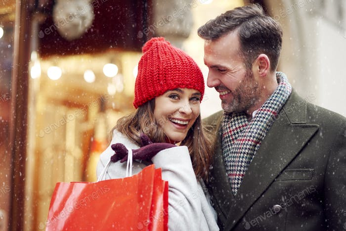 Couple spending some money during Christmas shopping