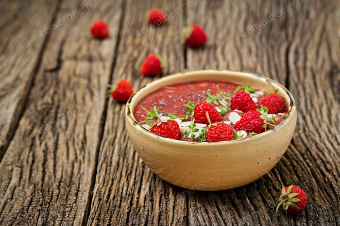 Vegan chia seeds pudding with strawberries and almond.