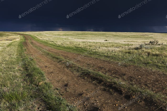Dark storm clouds of over Grasslands National Park, Saskatchewan, Canada.