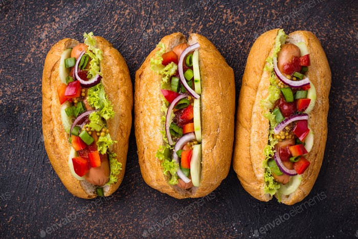 Hot dogs with sausage, sauces and vegetables