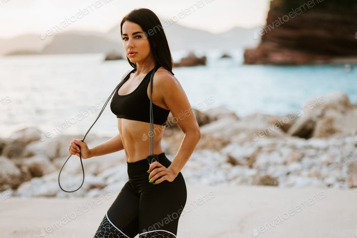 sporty woman posing outdoors