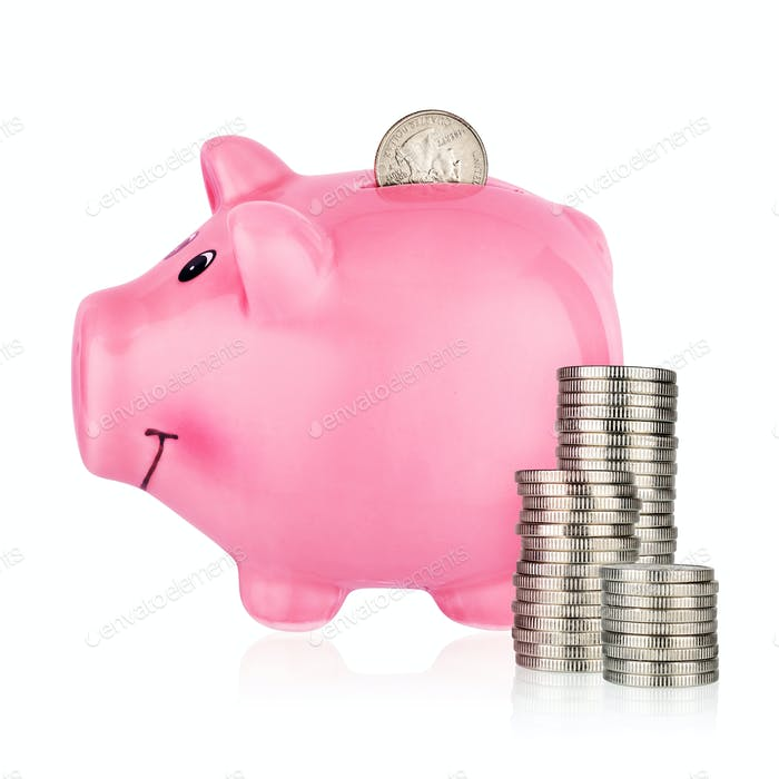 Piggy bank with stacks of coins isolated on white