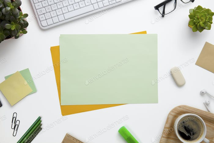 Blank Documents Surrounded With Office Supplies On White Desk