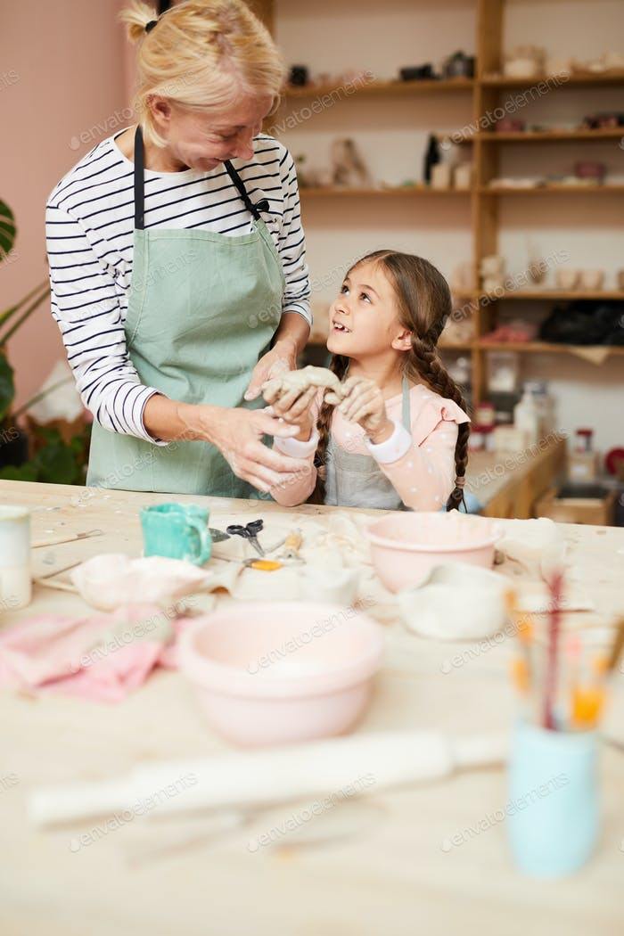 Little Girl Enjoying Pottery