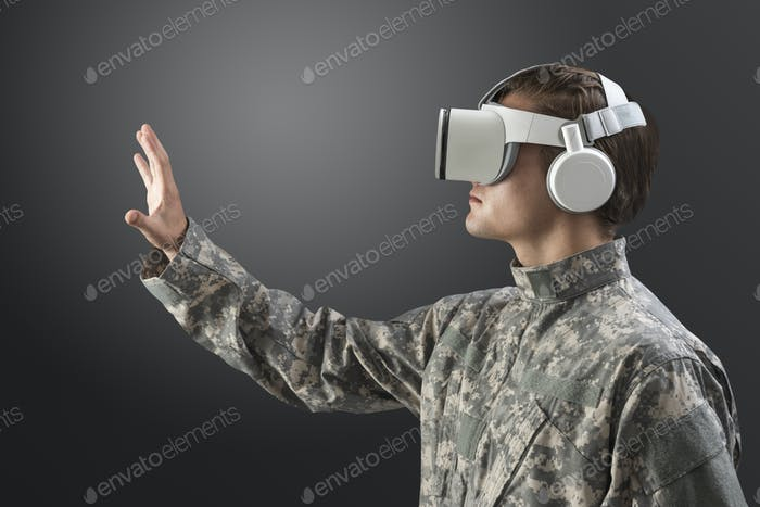 Military man with VR headset in training military technology