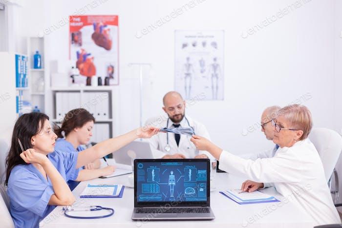 Matude doctor giving radiography