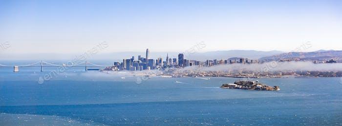 Panoramic view of San Francisco's skyline and Alcatraz Island on a sunny day, California