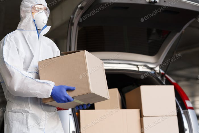 Man in coronavirus suit delivering goods, products and medicine