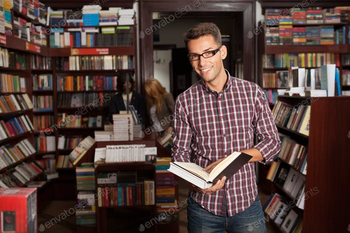 young attractive guy in a bookstore