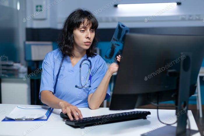 Nurse analyzing radiography for medical diagnosis