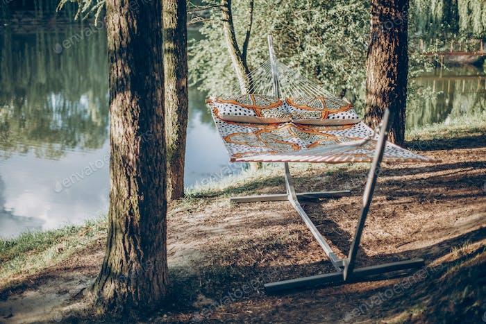 Ropes of stylish travel hammock in summer sunny park