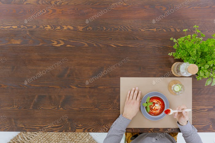 Person sitting beside rustic table