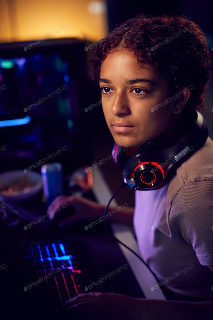 Thumbnail for Teenage Girl With Headset Gaming At Home Using Dual Computer Screens