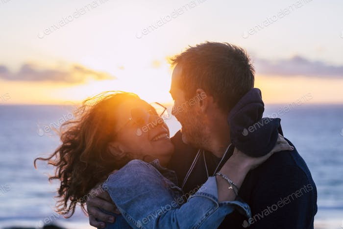 Romantic couple hug and kiss having fun