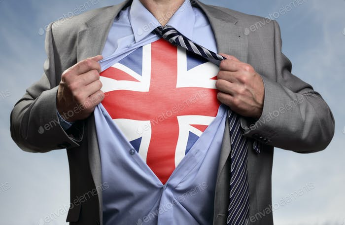 Superhero businessman revealing British flag