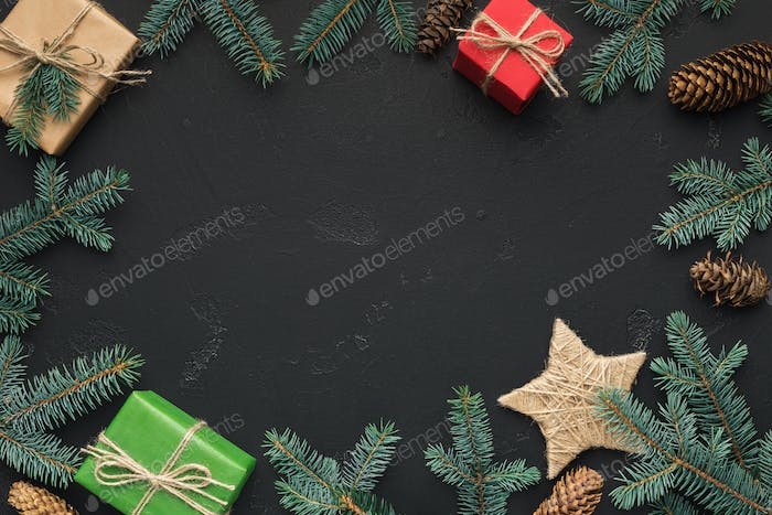 Christmas frame of fir tree and gift boxes