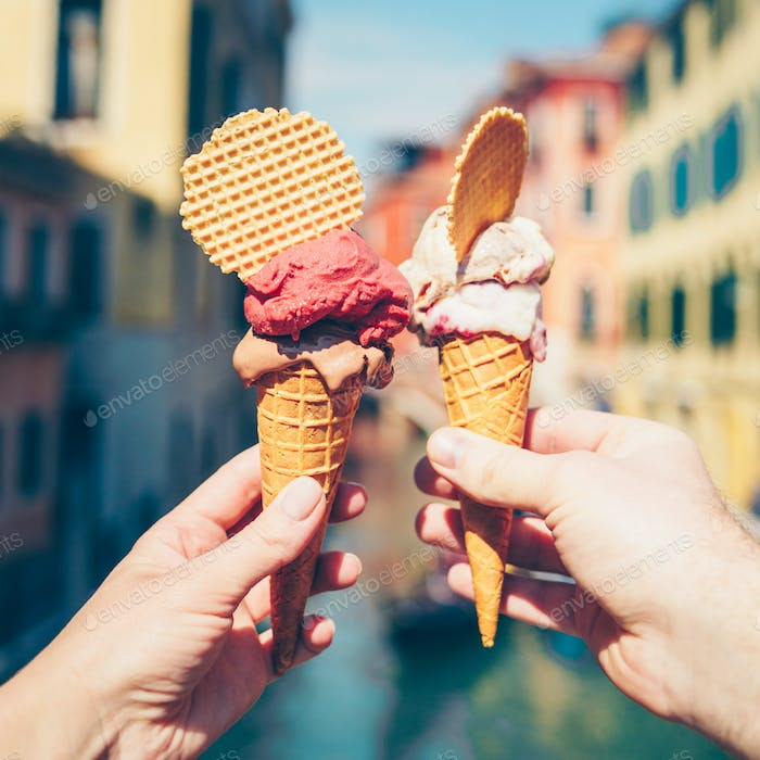 Hands Holding Ice Creams.