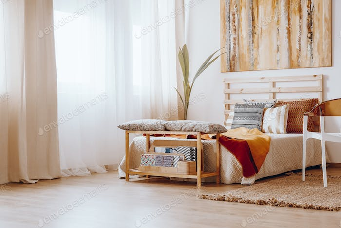 Bed in bright room