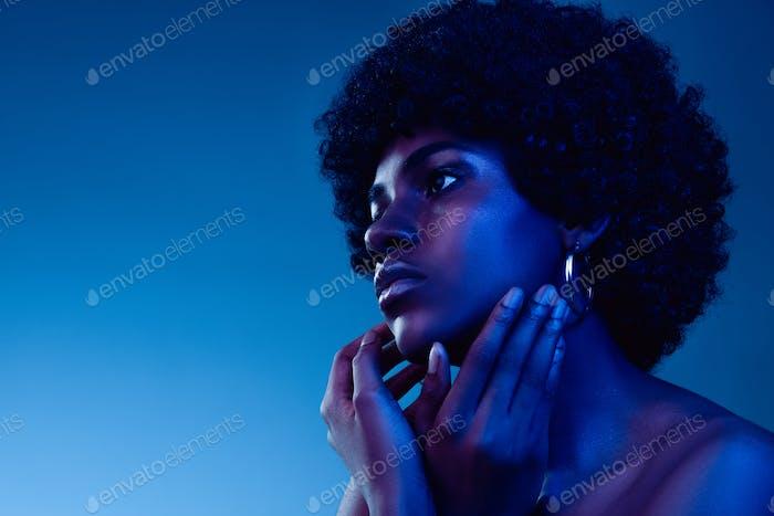 Portrait of female high fashion model in neon light