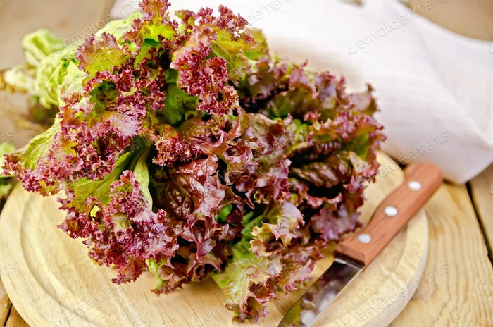 Lettuce red with a knife on board
